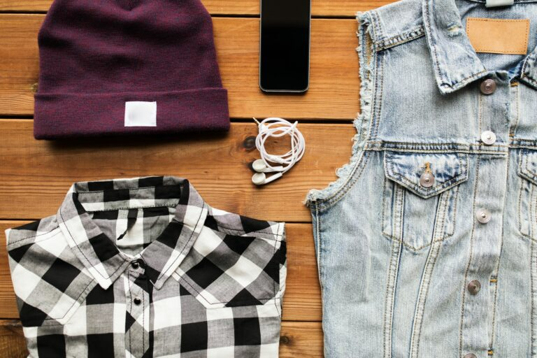 clothes and smartphone with earphones
