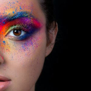 Close up view of face with multicolored makeup