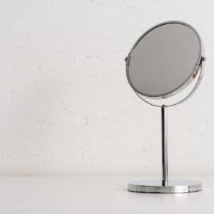Round Mirror on White Background, Zero Waste Concept