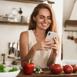 Smiling attractive young woman using mobile phone