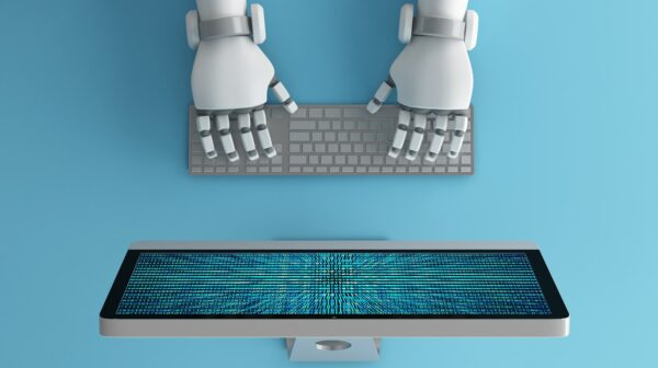 Top view of Robot hands using keyboard in front of a computer monitor with binary number code screen