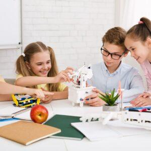 Children constructing robotic device at stem class