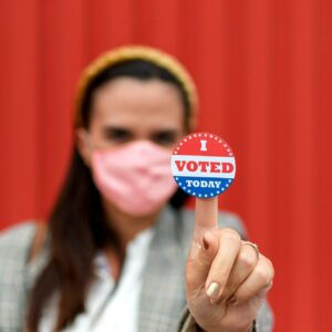 Woman holding voting sticker, selective focus, vote, i voted today, usa, presidential election.