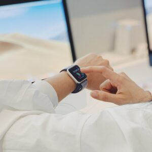 Woman using smart watch, wearable technology product