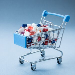 A concept of a retail shopping trolley or card filled with medicines including antibiotics and