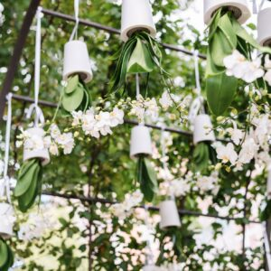 An arbor decorated with white orchids.
