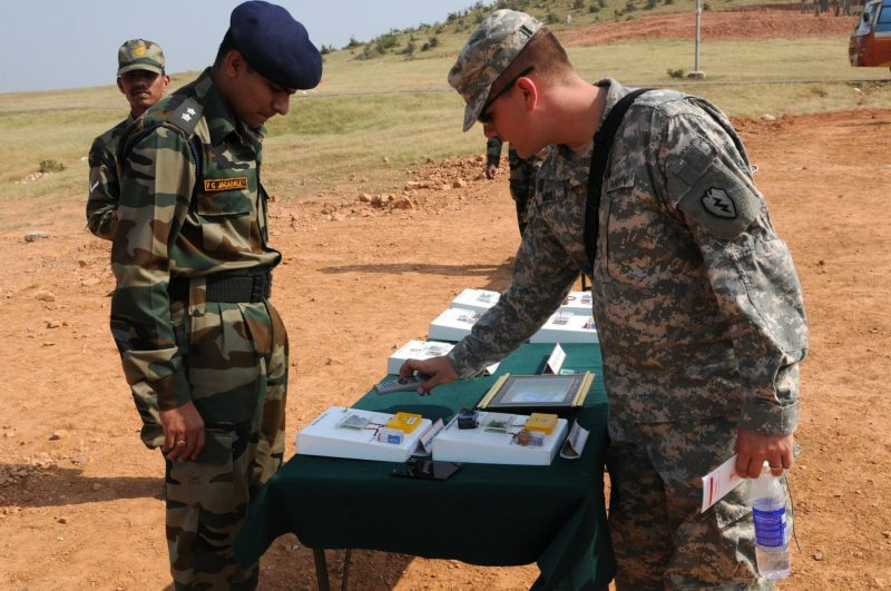 Lt. Vignesh Jagadale, engineer platoon commander, 31st Armor Division Indian army, explains how Improvised Explosive Device (IED) detection equipment works for Pfc. John Mould, Intelligence analyst, Headquarters Troop, 2nd squadron, 14th Cavalry Regiment,