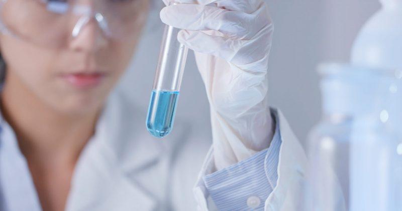 Laboratory technician observation on test tube