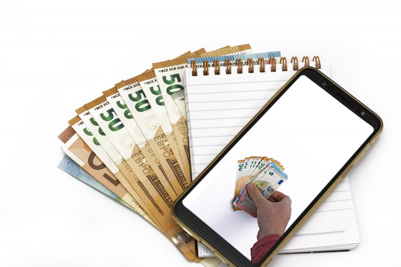 Mobile Smart phone and euro cash, digital money and fintech concept