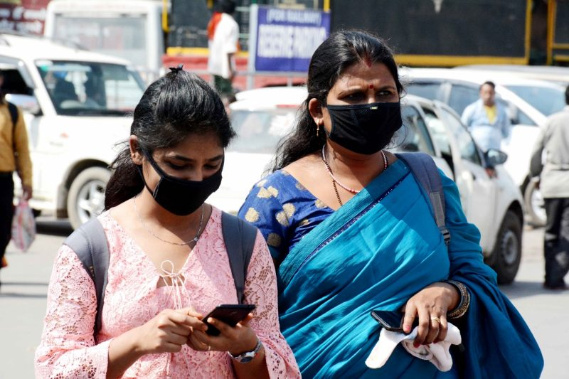 Patna: People wear masks as a precautionary measure against COVID-19 amid coronavirus pandemic, in Patna on March 20, 2020. (Photo: IANS)