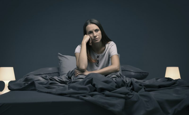 Stressed woman suffering from insomnia